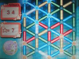 くるけし!プレイ画面/画面右上の三角形を240度回転させると3デカデルタとなる/(c)2006 NINTENDO